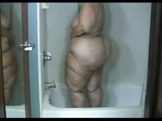 grown-up obese brunette acquires a bathroom and