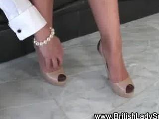 cougar brit femdom shoe posing for the camera