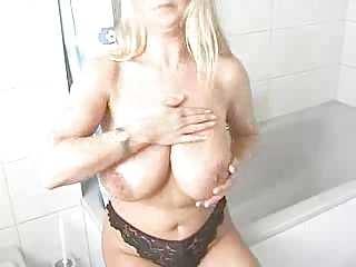 bleached woman lathers lotion all over her very