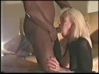 blond mature sucks on a brown cock and takes