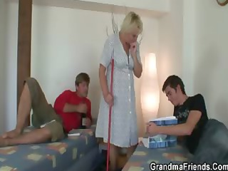 two men screw cleaning granny