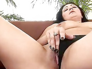 mature grace uses a vibrator on herself