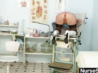 pale granny medic self exam with kitty spreader