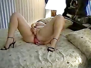 ancient woman uses two sex toys on bed. fresh