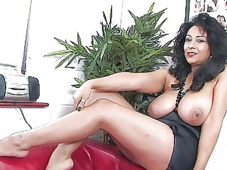 alluring dark haired slut with large honkers