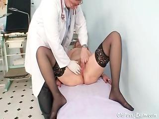 redhead elderly immodest muff stretching in gyn