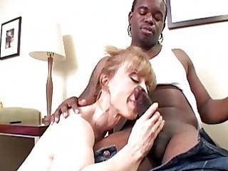 classy blonde milf slurps on raging black boner