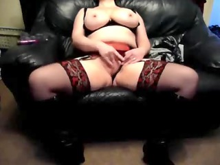 naughty lady on a leather furniture at house