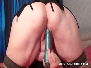 bleached mature tramp licking her big boobs