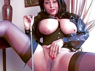 arousing brunette momma into corset and stockings
