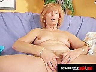 redheaded granny uses a sex toy