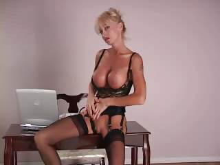 mature babe with big silicone bossom dildoing