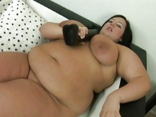 giant dark haired momma with huge chest uses her