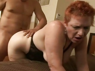 redhaired elderly acquiring her slut pleased on a