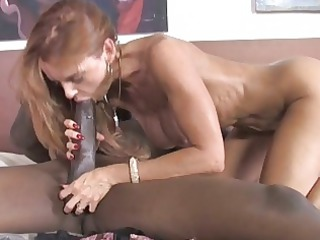 busty cougar takes a giant dark libido