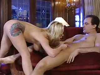 tattooed mature babe whore gets a tough xxx titjob