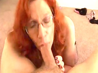 grown-up redhaired takes a cumshots on her large