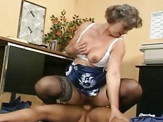 older demonstrates her chest and hairy vagina