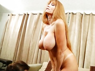 large busty lady obtains titty fucked