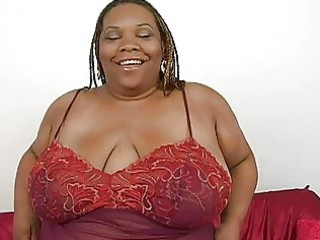 plump dark momma with big bosom pleases with her