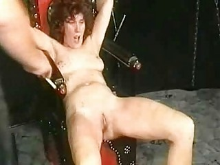two masked masters in a dungeon spank woman slave