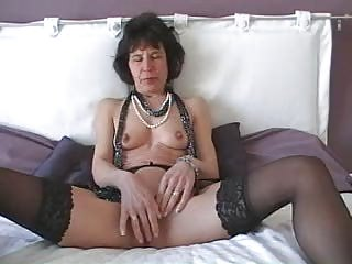 mature with plastic cock does herself