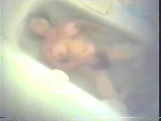 bushy lady pushing dildo in shower tube.