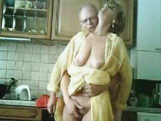 woman and dad having pleasure inside the kichten.