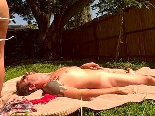lady sunbathes while gangbanging