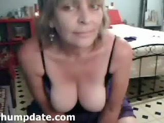 older babe with giant bossom pleasing on webcam