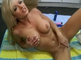 super milf inserting sex toy in anal
