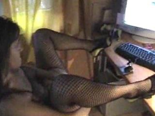 older girl pleases inside front of webcam