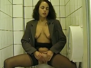 public toilet cock sucking and peeing with