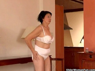 over 70 granny does striptease and plays