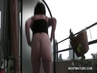 curly orgasm craving cougar plays on terrace