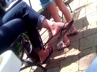 candid feet woman flipflop dangle