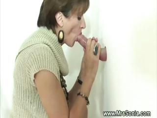 cuckold sees busty lady licking gloryhole libido