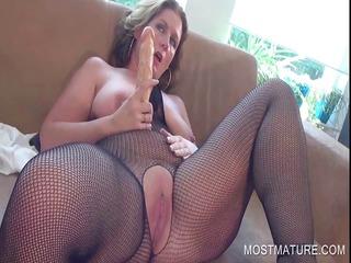 busty older pleasuring clitoris