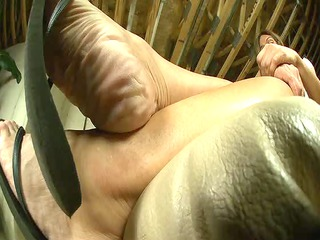 grown-up wrinkled legs into flip flops