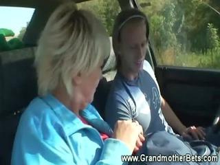 old enjoys sucking penis inside car