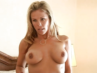 bleached milf rubs her huge bossom with a lotion