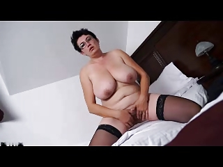 fat cougar brunette exposes and plays on berth