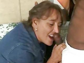 busty fat woman gang-bangs large dark cock while