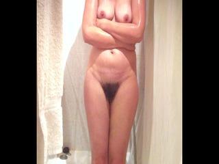 spying sweet curvy lady getting a bath