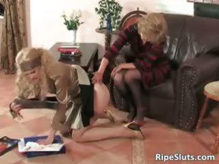 desperate grownup whore puts strap on plastic cock