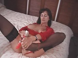american milf fucks herself with a pair of high