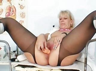 pale woman inside latex uniform extreme plastic