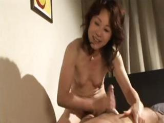 busty japanese mature babe gives him head and